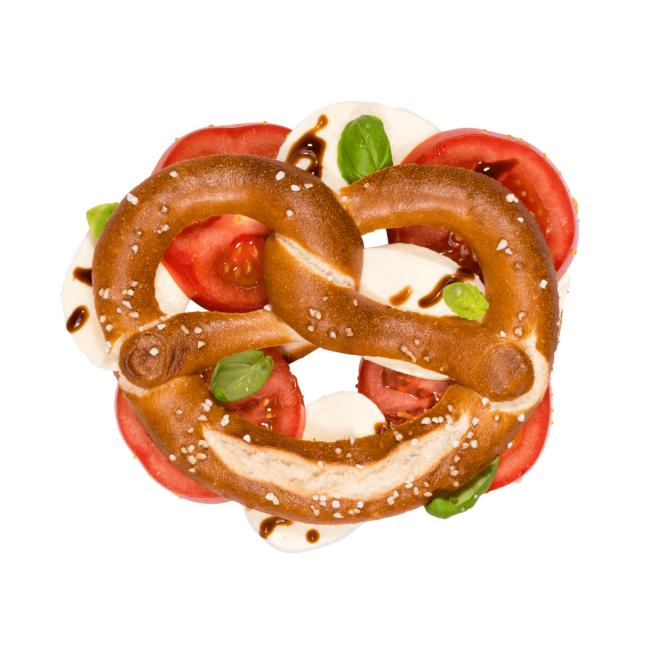 Die Brezeln mit Tomate und Mozzarella ist richtig lecker und schmeckt.